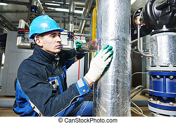 industrial worker at insulation work - industrial...