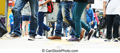 pedestrians moving on the street - Pedestrians crossing a...