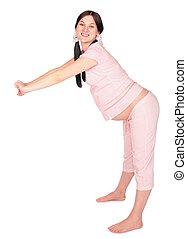 Pregnant girl doing exercises