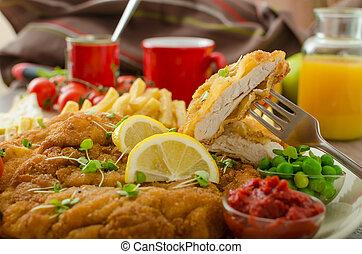 Schnitzel, french fries and microgreens salad - Schnitzel,...