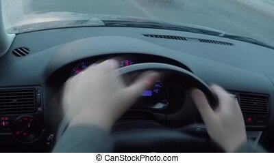 The driver behind the wheel driving - The driver behind the...