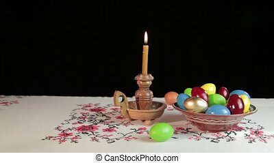 Orthodox Easter. On the table is a plate with colored eggs....