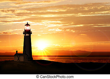 Lighthouse at sunset - Lighthouse searchlight beam near...