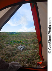 view from doors of tent - view of landscape from doors of...