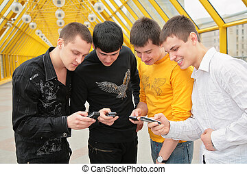 group of young men with cell phones