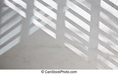 Sunlight shade on white wall
