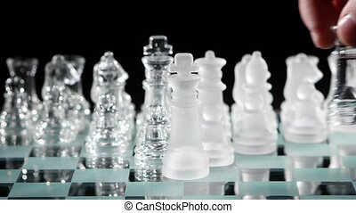 Beautiful pieces on the chessboard on black background. Slow...