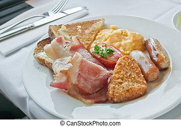 Big breakfast on white plate