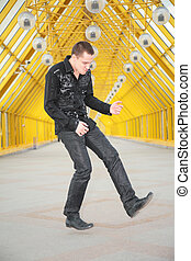 guy  allegorize play on  guitar on footbridge