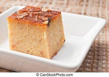 """""""Mung Bean Thai Custard Dessert Recipe, Khanom Maw Kaeng""""(thai name) made with eggs and pumpkin, Ancient thai dessert in white bowl on fabric"""