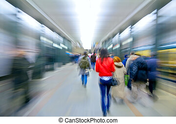 abstract red woman in zooming people on metro station