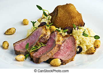 Duck breast steak with couscous - Grilled duck breast served...