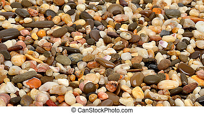 Many-colored little stones on the beach
