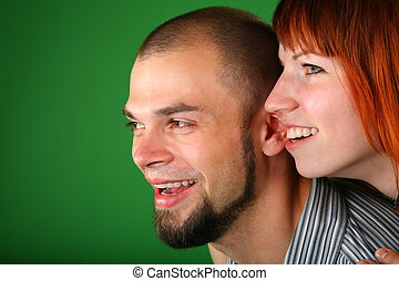 beard red couple smile faces on green