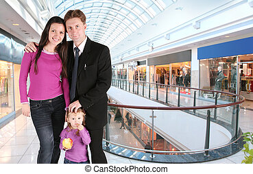 family with girl in universal store