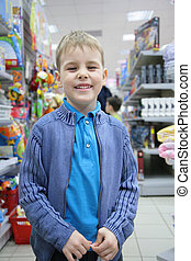 boy in toy section in shop