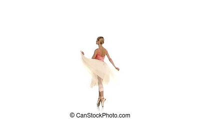 Young girl spinning and dancing ballet, on white background,...