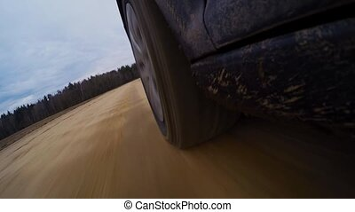 Cars wheels in mud in the forest, off-road Driving at...