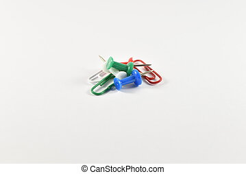 chancellery - colored paper clips and pins
