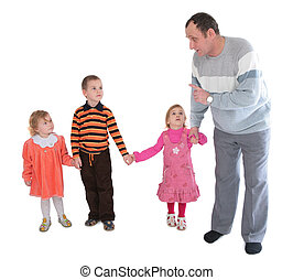 Man talking to three kids