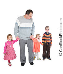 Man with three kids posing