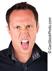 angry man shows tongue
