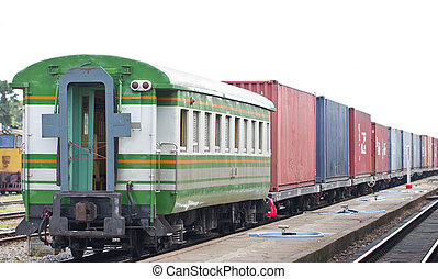 Cargo train on track at station, Thailand.