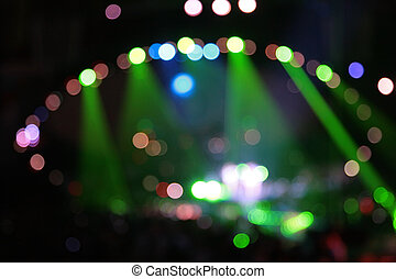 abstract defocused color spotlights on concert