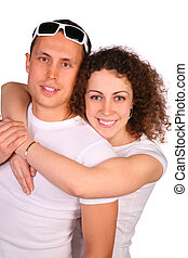 Girl embraces young man