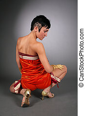 dancing woman in red from back