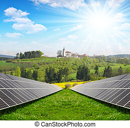 Solar energy panels in spring landscape. Green energy.