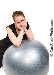 bored woman who is unwilling to exercise - woman who is...