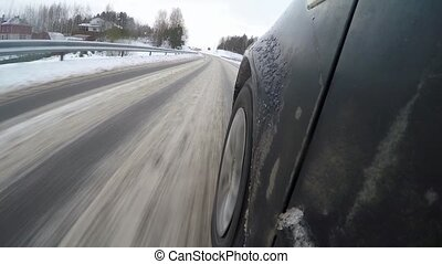 Car driving through a winter storm with snow