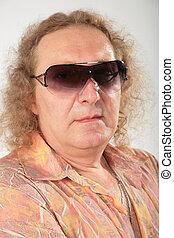 big fat curly man in sunglasses