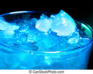 Blue cold cocktail on dark background - Blue cube ice of...