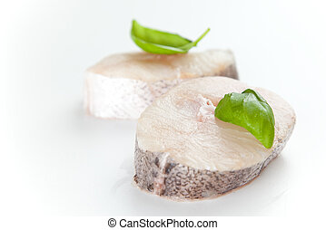 Fresh slice of hake - Fresh hake slice isolated over white...