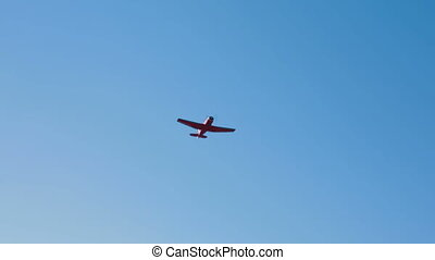 Small Plane Flying In Blue Sky - Camera is following a small...