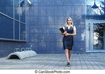 Business woman walking in the street