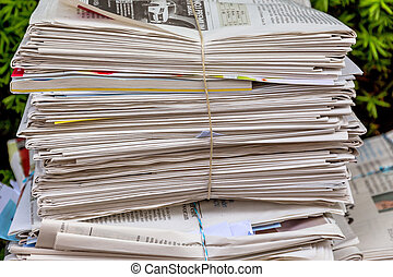 stack of waste paper old newspapers - a stack of old...