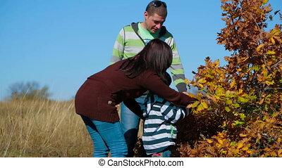 Happy Young Family Near Autumn Bush