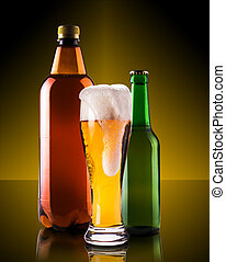 assortment beer bottles on a dark background