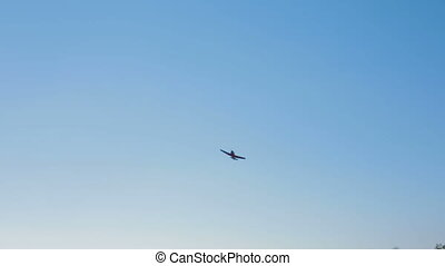 Small Airplane Flying In Blue Sky - Camera is following a...