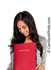 woman with application portfolio - a young woman holding a...