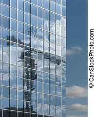 Mirror - The mirror facade of the building, in which is...