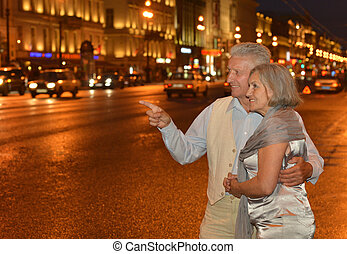 Amusing old couple - Portrait of amusing old couple on night...