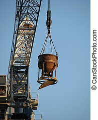 Raising - The building crane, raising a bunker with concrete...