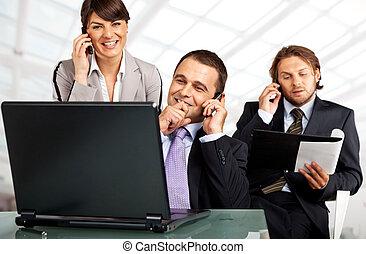 successful team phones and laptop