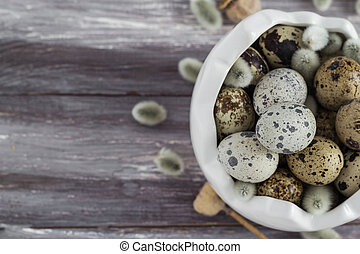 Small quail eggs wooden table dish scattered database -...