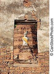 Buddha statue in Ancient city of Ayutthaya, Thailand - Half...