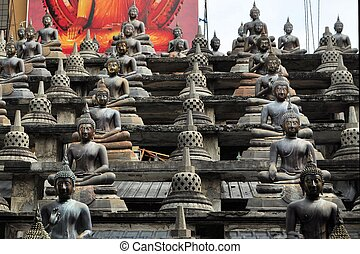 Buddhas and stupas in Colombo Sri Lanka - Set of Buddha...